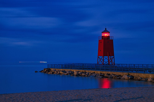 charlevoix michigan southpierlight lighthouse lakemichigan longexposure beach clouds sky pier bluehour beyondbluehour