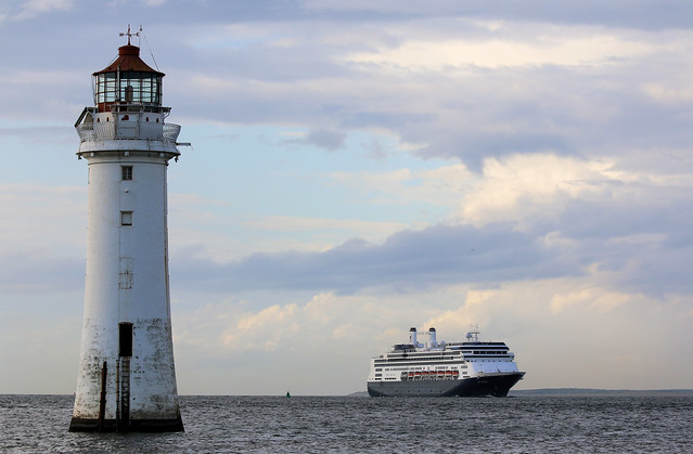 9th August 2019. Holland America Line cruise ship, Rotterdam, enters the Mersey, seen from New Brighton, Cheshire