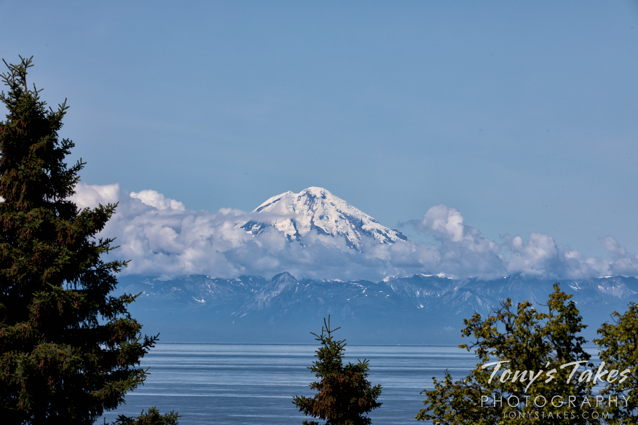 Mount Redoubt is seen from the other side of the Cook Inlet in Alaska. (© Tony's Takes)