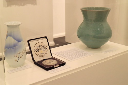 Green-glazed ceramic vase by Shigeo Shiga, medal and porcelain vase.