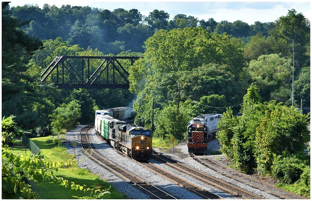 CSX 865 and Wheeling & Lake Erie 3064 both waiting for clearance to enter Connellsville, PA. Photo 1 of 3