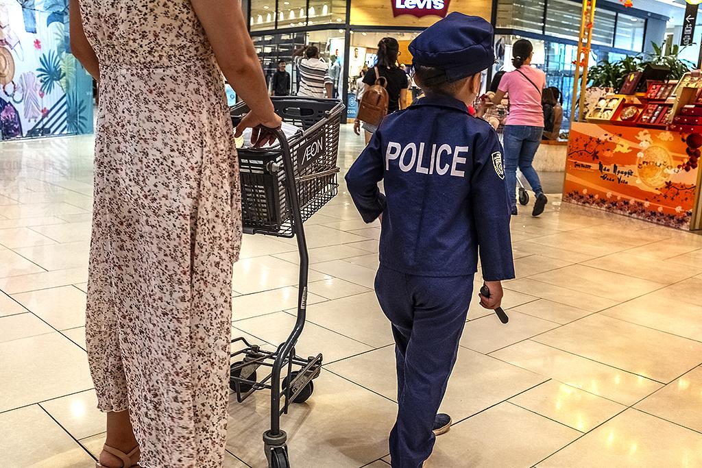 Boy in American police uniform at Aeon Mall--Saigon