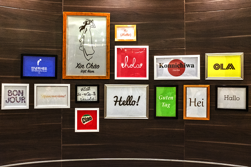 Hello in various languages at Aeon Mall restroom entrance--Saigon