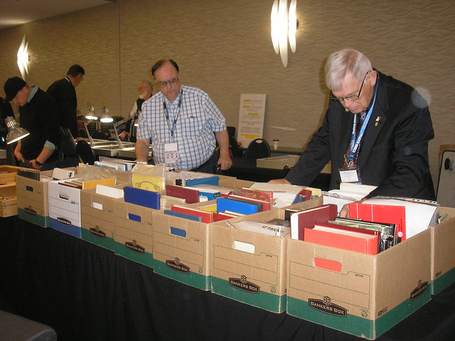 Paul Johnson, Executive Secretary of the RCNA (left) and Clifford Mishler, official representative of the ANA at the RCNA (right) looking through my stock