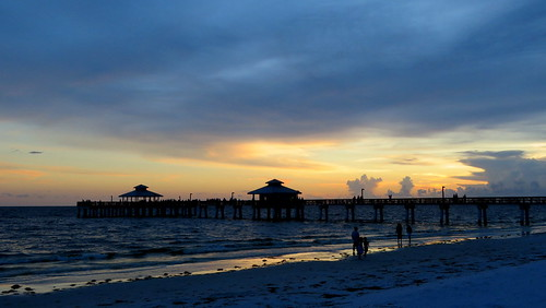 sunset pier clouds fort myers beach fl florida