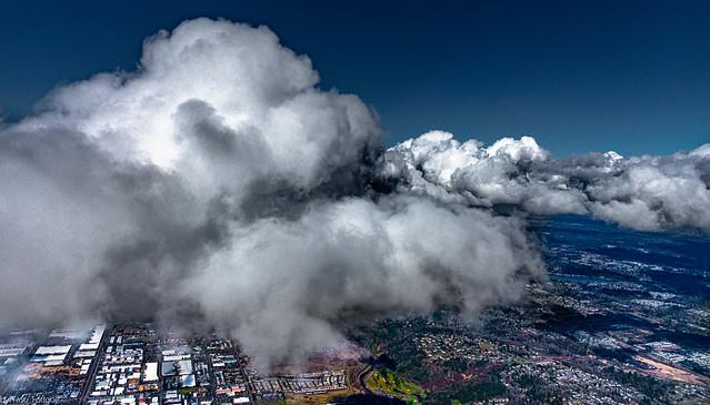 Flight over Tacoma city at cloud level, WA, USA- 5
