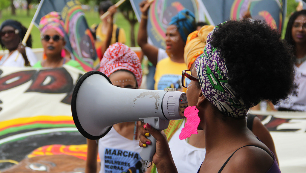 A protesting woman with a megaphone.