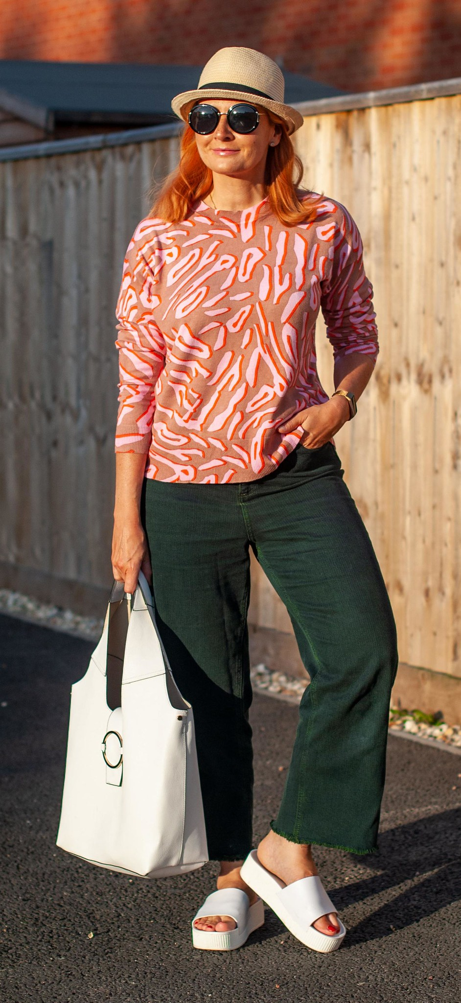 Over 40 Fashion: Cooler Summer Weather Outfit of Pink and Green \ pink and camel leopard print sweater \ wide cropped dark green jeans \ straw hat \ white flatform sandals \ white hobo bag | Not Dressed As Lamb
