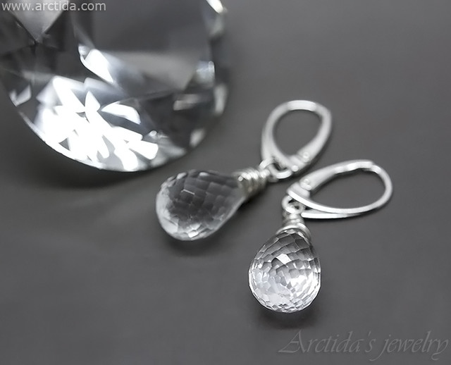 Elsa - Rock Crystal Clear Quartz earrings wire wrapped in sterling silver. Jewelry design by Arctida.
