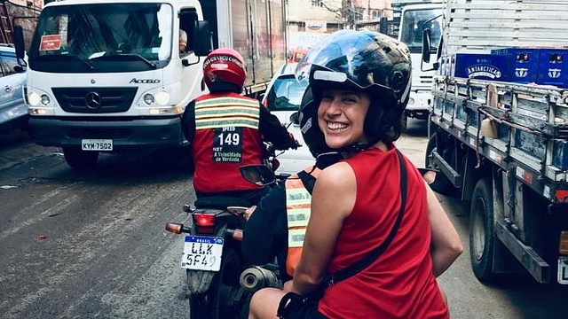 Jessica riding a moped in Rio