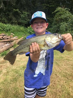 Photo of boy holding largemouth bass