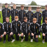 Under 17s team with Coaches Iain Ralston (right) and Raymond Mathers (left)