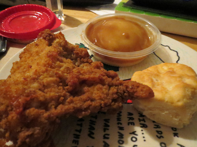 Chicken, Mashed Potatoes And Gravy With A Biscuit.