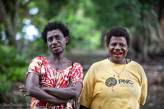 Women with betel nut smile, Mioko Island, Papua New Guinea, July 2019. Chewing a betel nut produces red residue and acts as a mild stimulant.
