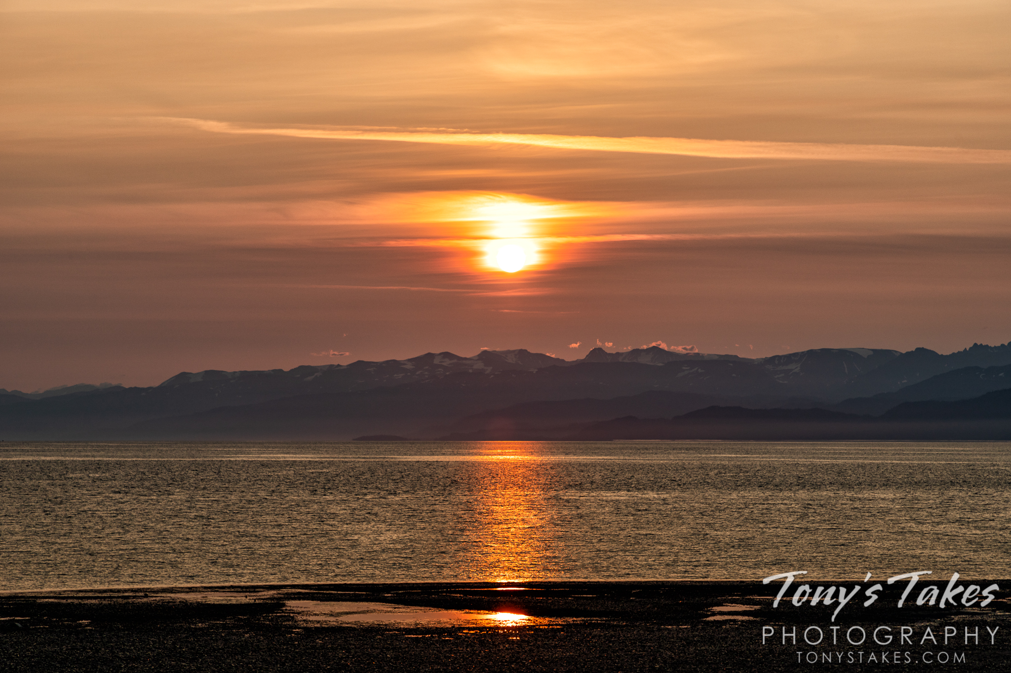 The sun rises across Kachemak Bay in Homer, Alaska. (© Tony's Takes)