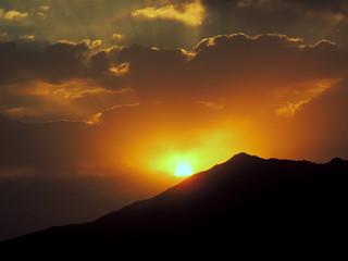 Beautiful sunrise sky behind mountain silhouette