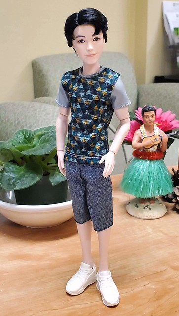 Honestly, he's the cutest thing!  The new Ken outfit works - the T fits perfectly, but the shorts need to be pinned a little in the back.  Most Ken pants (even vintage) are too large around the waist.