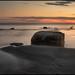 Sten i solnedgång