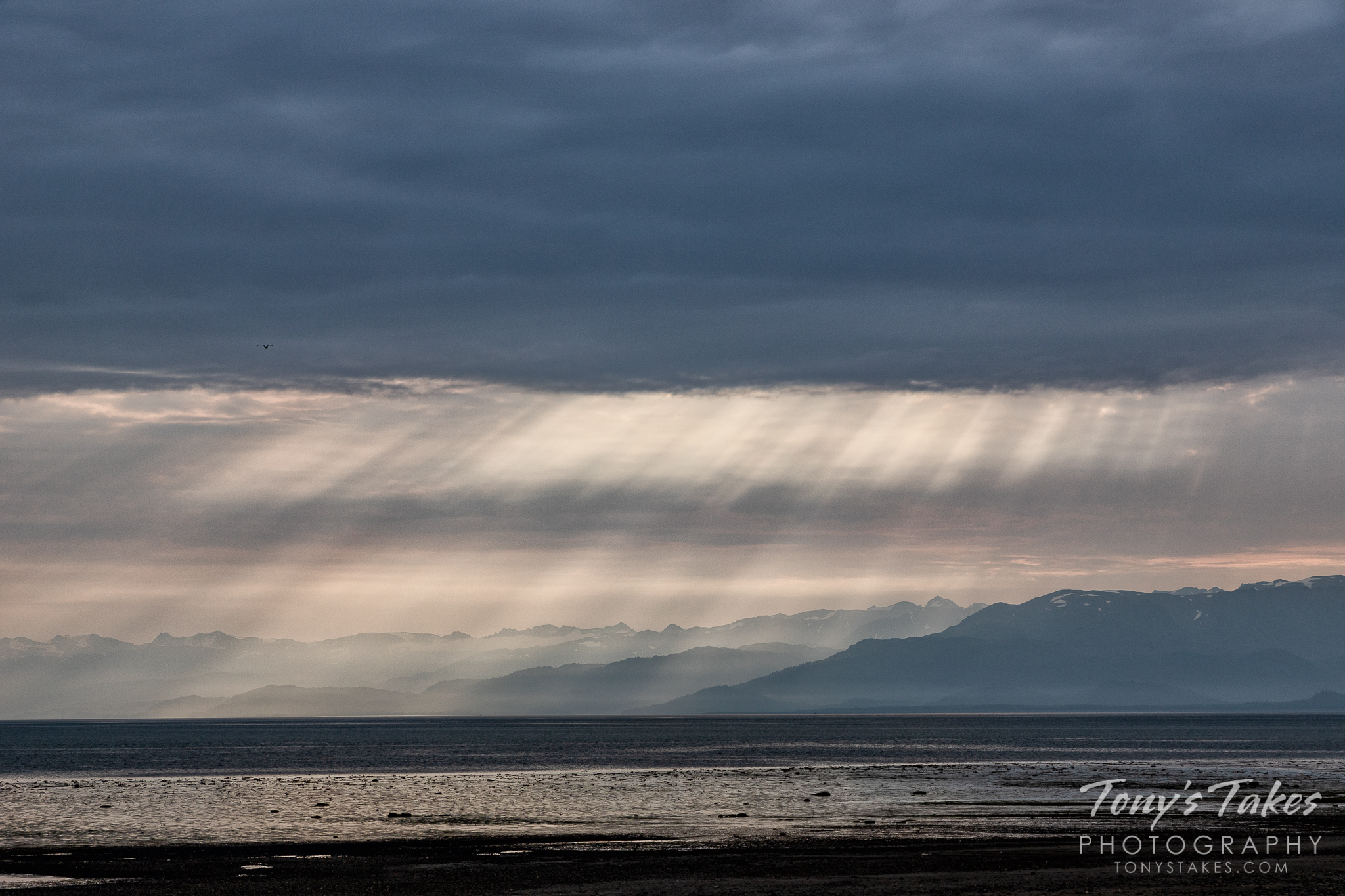 Streaking rays of sun on Kachemek Bay