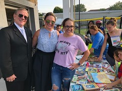 Rep. Cummings and volunteers from Waterbury Reads Gently Used Chuildren's Book Drive  handed out books during the Waterbury PAL Heads up for Safety event.