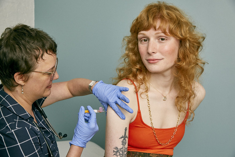 Woman receiving a vaccine in a doctor's office