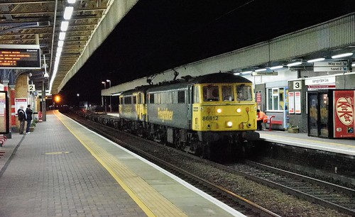 Freightliner's 86612 leads stablemate 86637 at speed through Warrington Bank Quay with 4S59 2059 Basford Hall to Coatbridge on 12th August 2019