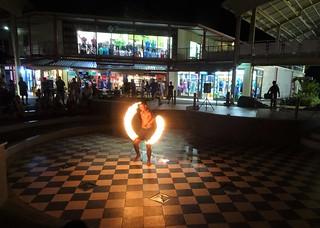 Fiji. Denarau Island marina. A circle of fire from one of the Fijian fire dancers in their free nightly show.