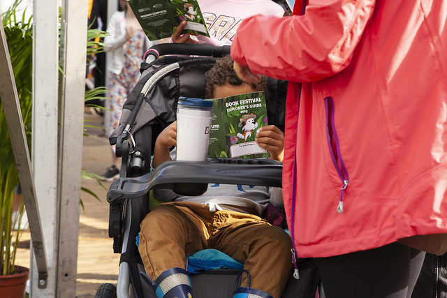Baby reading the Explorer's Guide