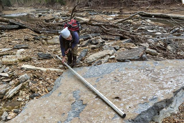 Korey Harvey measuring imbricated rock, Blackburn Fork, Jackson County, Tennessee 2