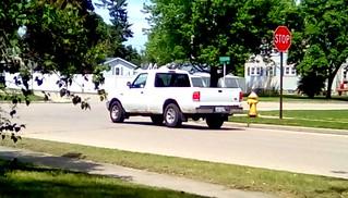 White pickup truck - HTT  Menominee Michigan