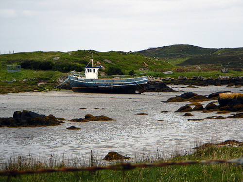 An inner channel with a boat just after Maghery Beach in Ireland