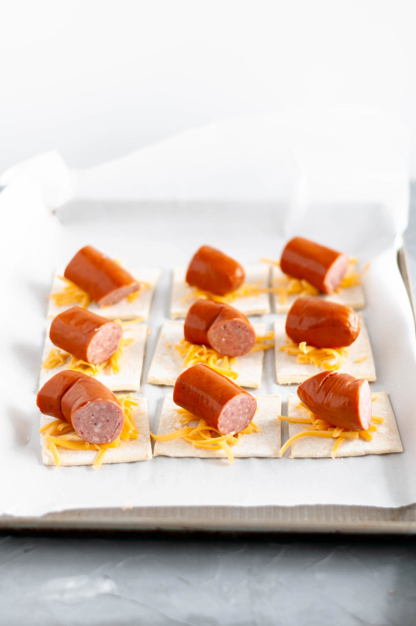 It's almost football season and that means it's time for all the football food and appetizer. Start the game with these Cheesy Pigs in a Blanket.