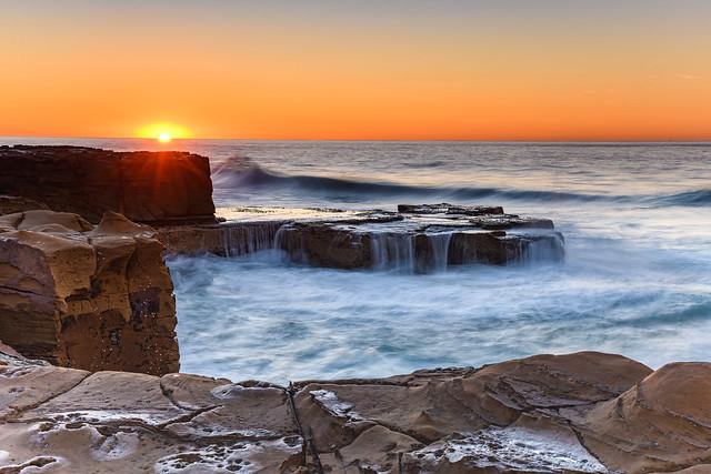 Clear Skies and Rocky Coastal Sunrise