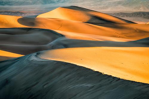 Shifting sun, shadows, and sand