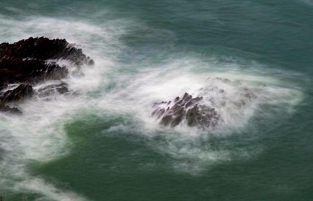 Rising tide envelop rocks.