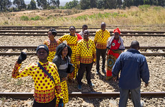 A group of locals who like to show their suits by the train at Makambako station, Tanzania, by the Tazara train