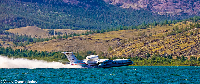 Russian airplane BE-200 taking some water from lake Baikal for fire-fighting operations