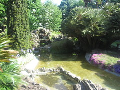 Waterfall fountain and pond in the park