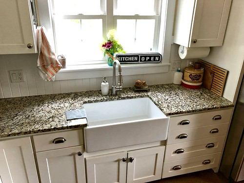 white farmhouse sink in kitchen