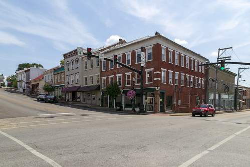 building structure buildings structures historic commercial threestory brick 11windows stone lintels sills storefronts awnings street hillside clouds 22windows friezeboard flemingcounty kentucky flemingsburg