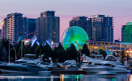 Marina boats, ferris wheels and condos at dusk - Toronto