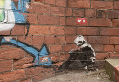 Banksy type hoodie graffiti