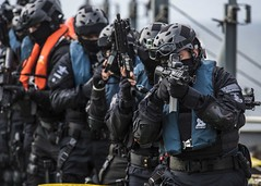 In this file photo, Royal Malaysian Police Force officers clear the main deck of a vessel during a visit, board, search and seizure (VBSS) practical training scenario as part of exercise SEACAT 2018. (U.S. Navy/MC3 Christopher A. Veloicaza)