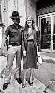 RONDA, a streetwalker, charms sheriff's deputy into posing with her