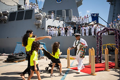 Command Master Chief Jose Romero greets his family during the USS Michael Murphy (DDG 112) homecoming ceremony, Aug. 19. (U.S. Navy/MC2 Devin M. Langer)