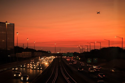 sunset eveing night dusk sky crimson scarlet cityscape highway freeway traffic subway station metra scenic interstate i90
