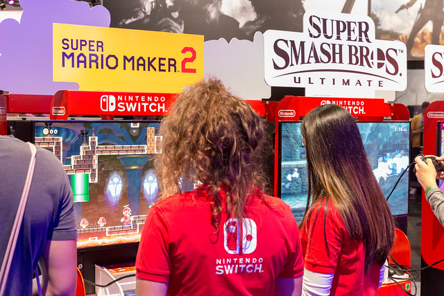 Girls at games fair Gamescom 2019 in Germany testing Super Mario Maker 2 on Nintendo Switch