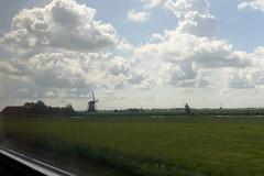 Fries Landschap met molen en wolken