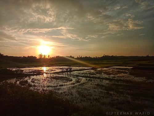 nature naturephotography beautiful beach lake reflection sky orangesky redsky redsun sun sunlight sunset landscape chittagong bangladesh outside outdoor nopeople mobilephotography mobileshot beginner beginnersphotography water