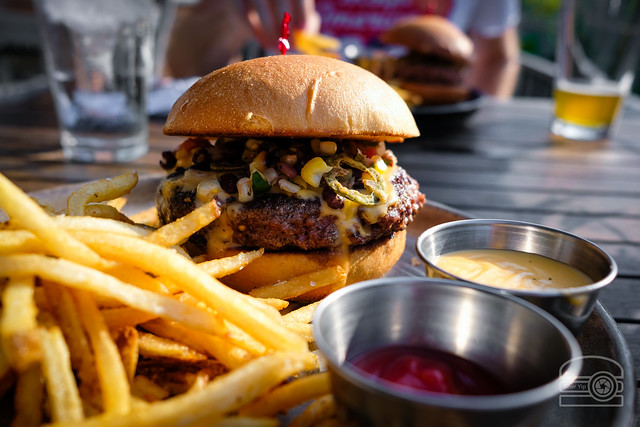 Burger w/ Queso, Black Bean Salsa, Fried Jalapeno - Table 9